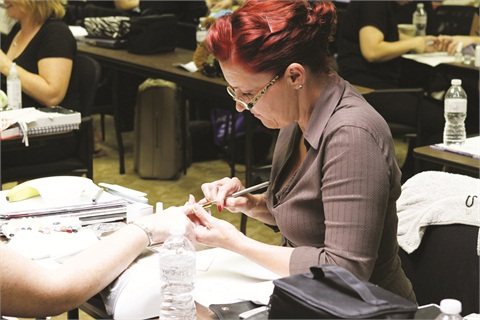 <p>Despite the language barriers, all the trainees learned a lot from each other. This international trainee is working on acrylics.</p>