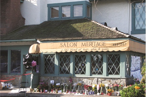 <p>Flowers and candles mark the site of the October 2011 shooting.  </p>