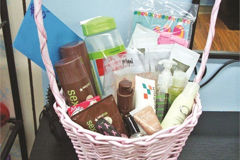 <p>For Bridgeville, Pa.-based Hair 2 Sole Beauty Studio's annual Boobie Bash (which raises awareness and money to fight breast cancer), the salon puts together a basket to raffle off to attendees, then donates the raffle ticket donations to charity.</p>