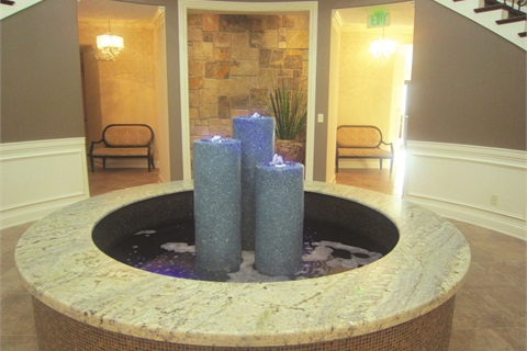 <p>A rotunda in the back of the salon features a peaceful water fountain that guards the entryway of Cali Spa's downstairs treatment rooms, which are reserved for waxing, facials, and massages.</p>