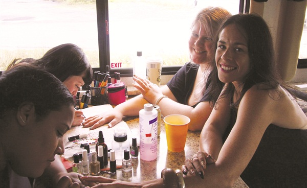 <p>Curator Rita de Alencar Pinto is the client in the front at one of her roving nail art parties, and nail artists Sophie Harris Greenslade (aka The Illustrated Nail) and Ami Vega (aka El Salonsito) are creating the nail designs. (Photography by Chloe Beck)</p>