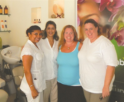 That's me with nail tech Veronica Espinosa, salon manager Helen Lopez, and nail tech Mariana Schpaliansky.