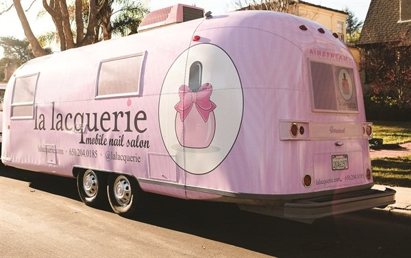 The bright pink trailer is hard to miss, offering up free advertising for the company.