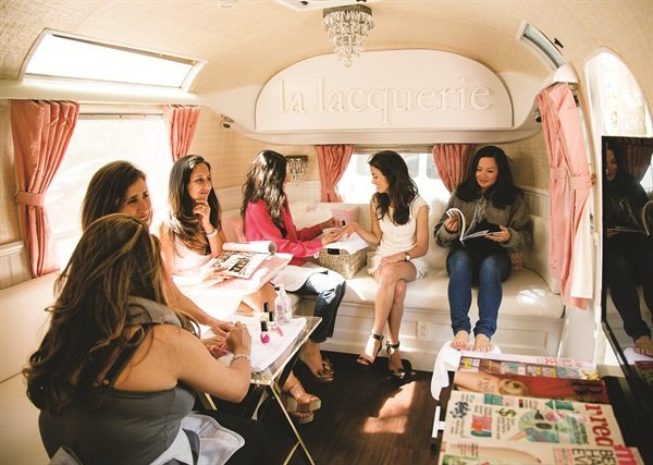 The mobile salon can accommodate about two nail techs at a time, with enough seating for about six individuals.