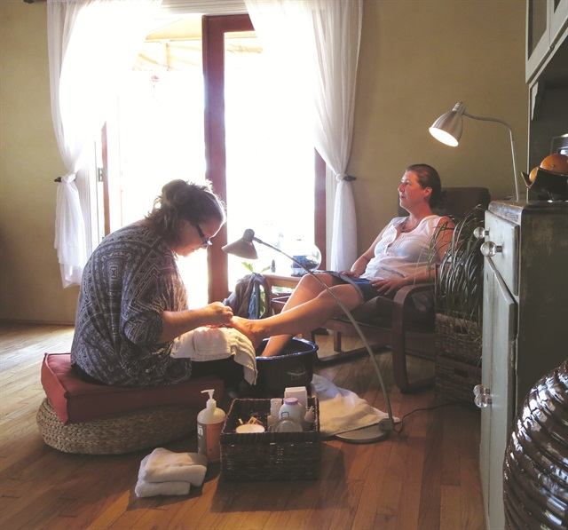 <p>My friend, Kim Coonen, enjoys Lentini's expert pedicure service.</p>