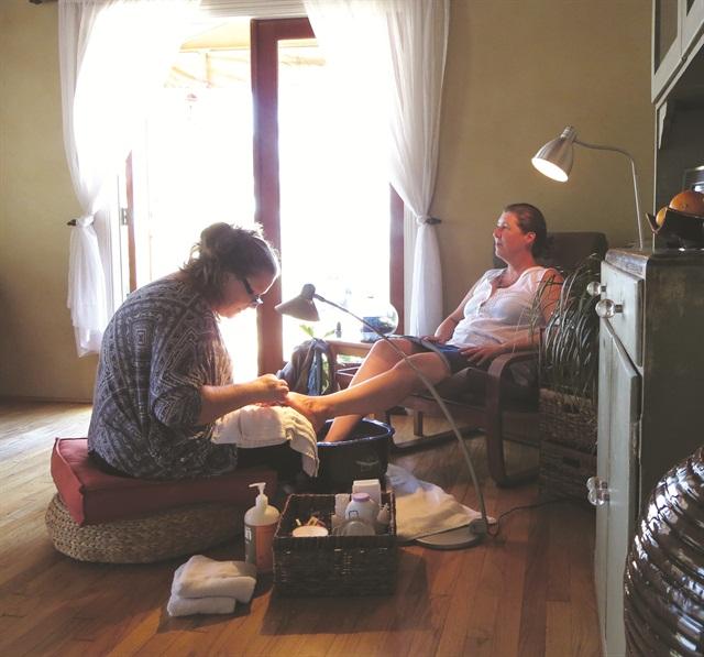 <p>My friend, Kim Coonen, enjoys Lentini's expert pedicure service.</p>
