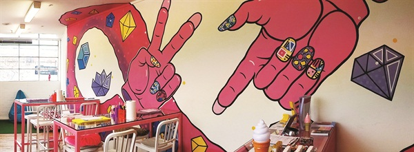 I Scream Nails is a small, cozy space with a big, bright personality highlighted by the pink hands and jewels painted on the wall.