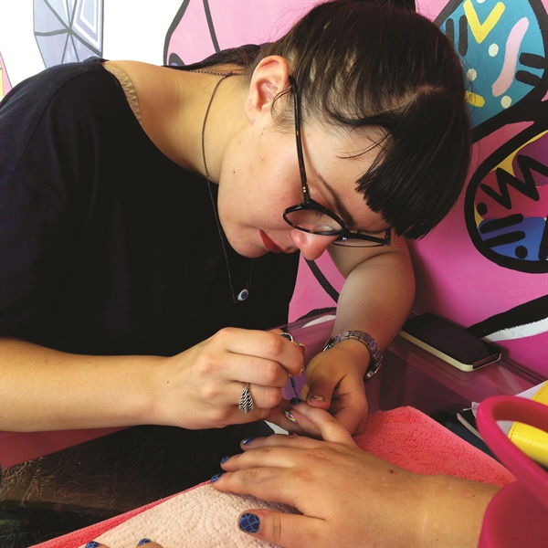 <p>A client is getting hues of blue by nail artist, Zinta.</p>