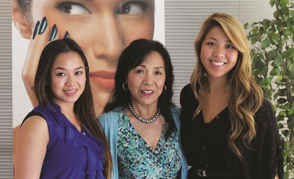 <p>Thuan Le (center), one of the first 20 licensed Vietnamese manicurists in the U.S., poses with AEC trainees Nhi Le and Amanda Pham.</p>