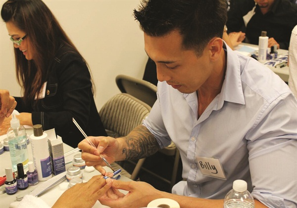<p>AEC trainee Billy Nguyen perfects his IBD Hard Gel technique.</p>
