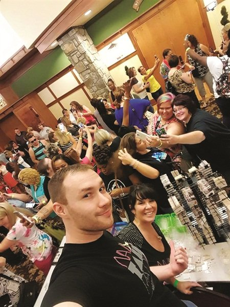 <p>Nail Talk Radio's Braden Jahr and Athena Elliott entertained the masses with a group selfie before the show doors opened.</p>