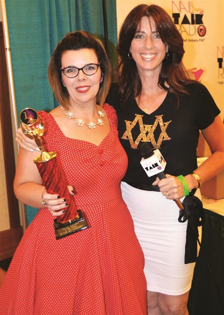<p>First place 3-D nail art winner Tracy Vinson of Forest, Va., poses with Amy Becker.</p>