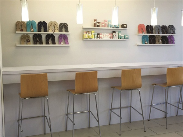 <p>Nail techs have a healthy habit of standing during manicures at Smudge's signature nail bar.</p>