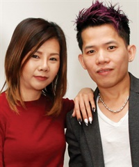 Tony Ly (right, with model Jennifer Dao Kim Khuu) has been a nail tech for 10 years. He traded his familiar glitzy style for a look that is just right for clients' holiday festivities.