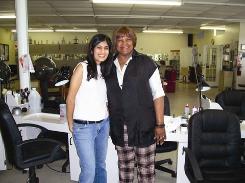 <p>Owner Roberta Hector (right) received her cosmetology instructors' license from Lee College in Baytown.</p>