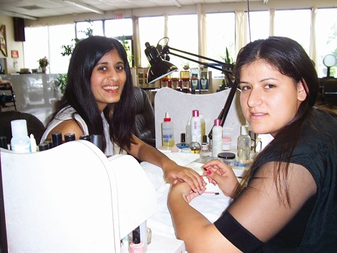 <p>Student Patricia Reynoso gives me a manicure.</p>