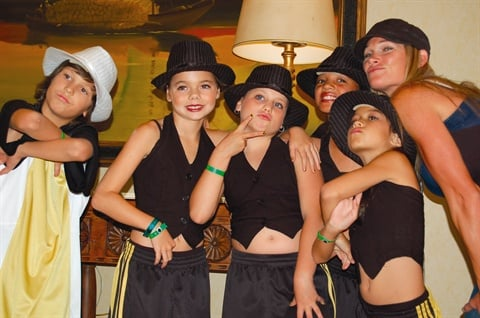 <p>Tom's youngest two kids recently competed in Hip Hop International's  World Hip Hop Dance Championships in Las Vegas. That's Brenden on the  left and Zoie third from left. His oldest son Gage plays on the high  school football team. Looks like he's got a family full of champions.</p>