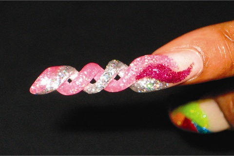 <p>Do even does acrylic spiral nails, a difficult design that is very popular in Puerto  Rico.</p>
