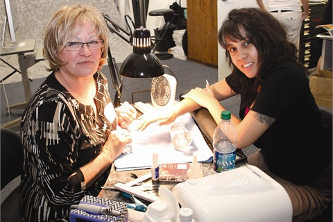 <p>Vicki Peters (left) is no stranger to cover shoots. She's done more than 200 covers in her illustrious 30-year career. Model Traycee King is no stranger to cover shoots either. Her hands and feet have graced the covers<br />of NAILS Magazine and sister publication VietSALON many, many times.</p>