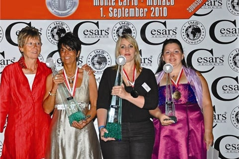 <p>(left to right) Annemarie Moser Proll presented the trophies to second-place winner Sabrina Siebert, first-place winner Emese Kppanyi, and third-place winner Eva Darabos.</p>