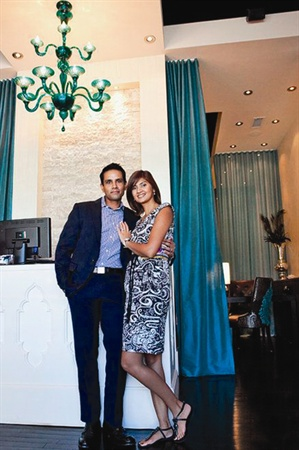 <p>Alap and Pinki Shah pose in Footique's reception area.</p>