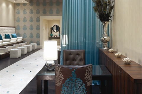 <p>Details on the custom-made manicure chairs feature the same European motif tht appears on the salon's ornate wallpaer.</p>