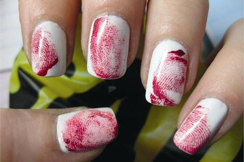 <p>Crimi-nails, in which Osburn dippered her fingertip into a custom red polish blend then blotted the polish off before pressing the red finger ont the nail, were an hommage to her crime show addiction.</p>