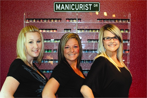 <p><em>Nail Candy's owner Alycia Barrett (center) with two of her three employees: Regina Selig (left) and Jodi Anderson (right). </em></p>