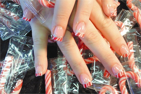 <p><em>Nail Candy nail techs make special candy cane nail art during Christmas.</em></p>