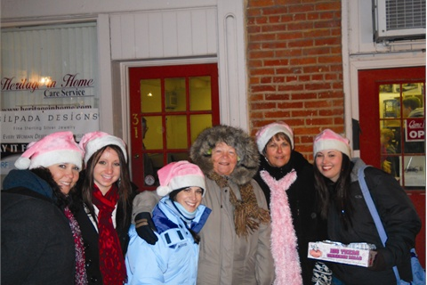 <p><em>The Valentine's crew and a client spreading Christmas cheer in downtown Greencastle, Pa. From left to right are Michelle Burkholder, Kayla Burkholder, Ashley Link, Helen Gearhart (client), owner Patti Valentine, and Jamie Hess.</em></p>