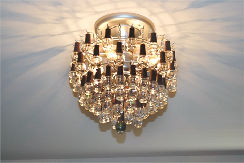 Shine on a chandelier made of polish bottles style nails magazine at well polished in katy texas clients just might decide on their pedicure color from a glimpse of the salons chandelier handcrafted by dr scott balin mozeypictures Gallery