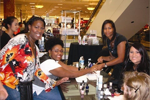 Owner Allisha Fitts performs a hand massage during an on-location event at Nordstrom.