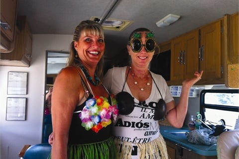 """<p><span style=""""line-height: 120%; font-family: 'Arial','sans-serif'; color: windowtext; font-size: 10pt;"""">Manicurist Shawna Strohte and masseuse Victoria Bradshaw represent On the Go Spa at themed events like this one at Santee Lakes RV Park Resort.</span></p>"""