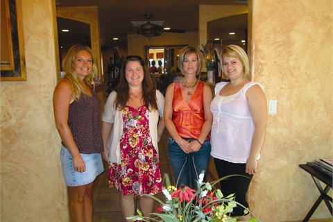 <p>Nail techs Tara Cook (left) and Sierra Mills (right) treated us to pedicures and owner Neva Spurgeon (second from right) welcomed us in to her salon. </p>