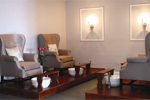 <p>The pedicure suite is a secluded room with flat screen TVs and wing chairs suited for customers seeking a little more privacy or tranquility.</p>