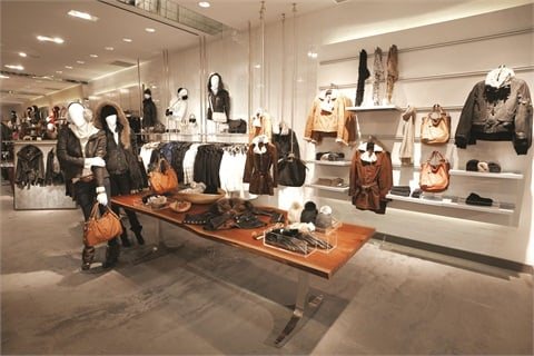 At Danier in Mississauga, Ontario, Canada, the first 20 feet are used to highlight a designer collection. It's a small space that can be easily updated and makes great use of the walls and the floor to tell a complete apparel and accessories story.