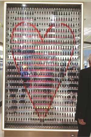 At John Lewis in London, a clear acrylic wall becomes an artful display for nail color.