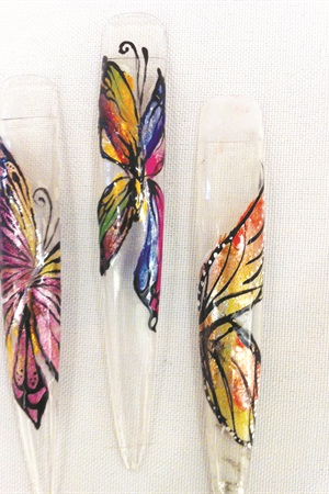 <p>These butterflies were created by Alisha Rimando-Botero using colored gel.</p>