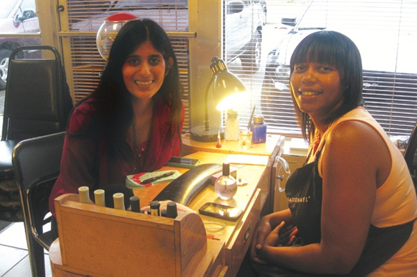 Tamika Johnson (right, with me)graduated from the Michigan College ofBeauty, a Pivot Point member school.