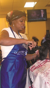 Owner Yody Greencuts and styles hair atthe pop ular salon.