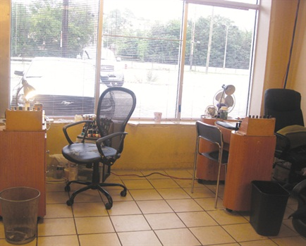 <p><span>The two nail tables occupy prime</span><span>real estate at Kut 'Em Up salon —</span><span>they are right at the front.</span></p>