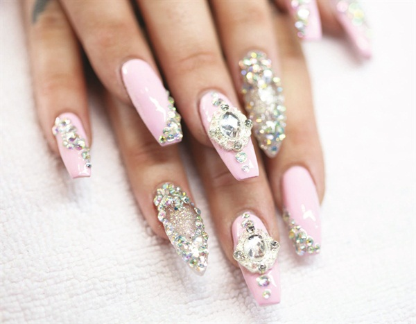 <p>The nail techs at Adore create customized nail art that they make as they go or at the client's request.</p>