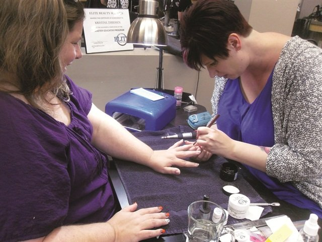 Kristine Thiessen makes it a point to explain to her clients why a thin gel application is best.