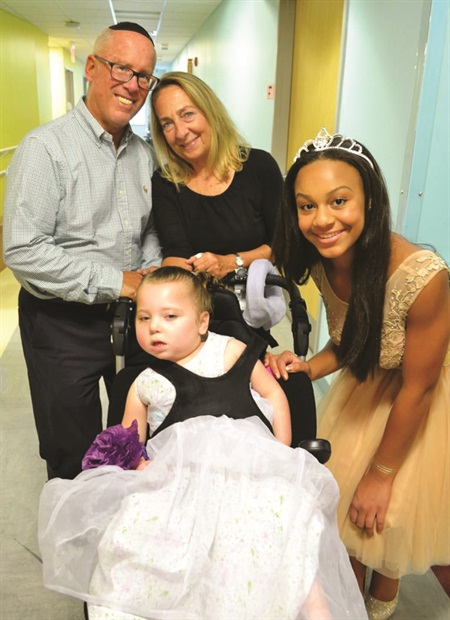 <p>Nia Sioux Frazier greets a young guest and her family.</p>