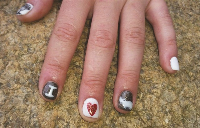 <p>Nina Ehlen of Adorabellas Salon in Lidwala, Swaziland, won the rhino nail art contest with these charming designs.</p>