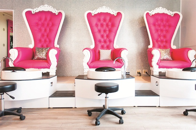 <p>Dallas Sauers, owner of Dallas Beauty Lounge, didn't want to have the typical black pedicure chairs found at most nail salons, so she went with custom-made pink and white thrones.</p>