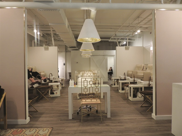<p>A sliding barn door adds a unique focal point at the back of the salon.</p>