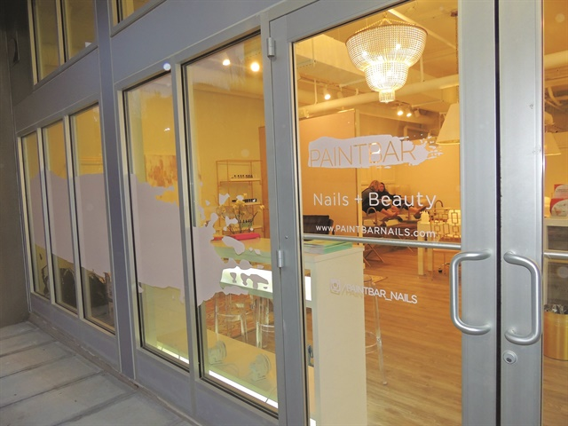 <p>The nail bar provides a good opportunity to people watch — for those looking in or out.</p>