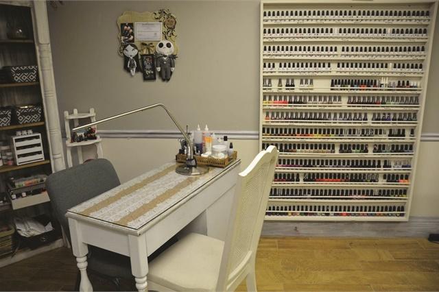 The nail desks are repurposed antique vanities.