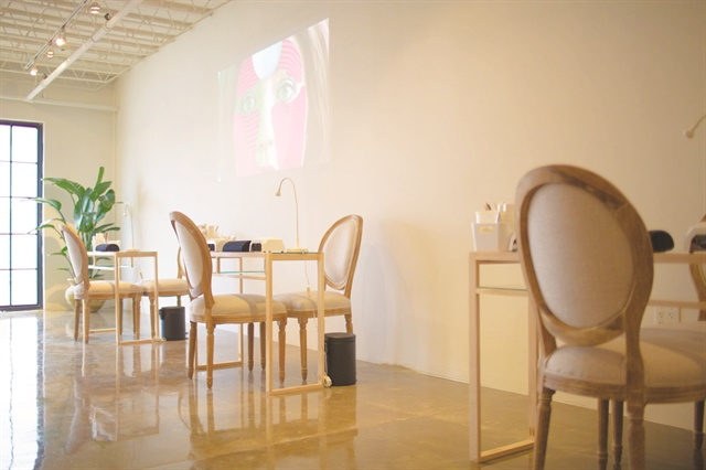 <p>Video art is screened on the walls and focuses on a range of topics including gender, immigration, and love.</p>